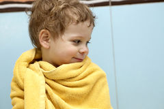 Kid wrapped in towel Stock Photo