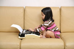 Kid Write With Typewriter Stock Images