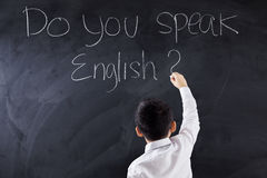 Kid writes text of Do You Speak English Royalty Free Stock Photography