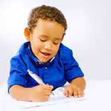 Kid writing Royalty Free Stock Images