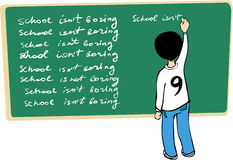 Kid writing on the blackboard Stock Photography