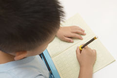 Kid writing Stock Images