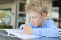 Kid writing Stock Photos