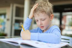 Kid writing Royalty Free Stock Photo