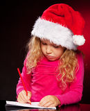 Kid writing a letter to santa claus royalty free stock image