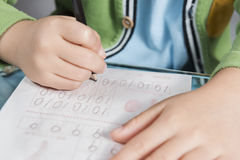 Kid writing numbers Stock Image