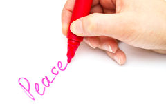 Kid writing peace Stock Image