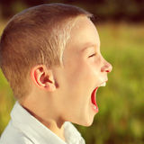 Kid Yell outdoor. Toned photo of Kid Yell outdoor Royalty Free Stock Image