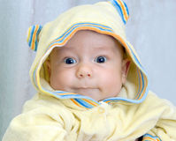 Kid in yellow  hood Stock Photography