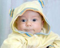 Kid in yellow  hood Stock Photography