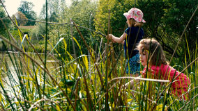 Kiddie Fishing Clip #2. Two little girls go fishing together on a pond - part 2 Royalty Free Stock Images