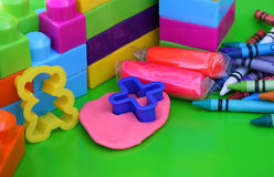 Kiddie Mess. Various educational toys including clay and building blocks Stock Photo