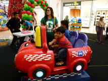 Kiddie ride. Children were enjoying a kiddie ride at a mall atrium in Sukoharjo, Central Java, Indonesia Stock Photography