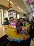 Kiddie ride. Children were enjoying a kiddie ride at a mall atrium in Sukoharjo, Central Java, Indonesia Royalty Free Stock Photography