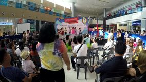 Kiddie school teacher coaching children perform on stage stock video