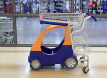Kiddie shopping cart. Out of a supermarket in amoy city, china Stock Image