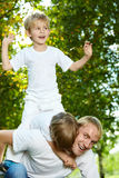 Kiddies. Father with two small sons frolic in park Royalty Free Stock Photo