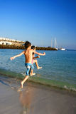 Kiddies fun race to beach Stock Image