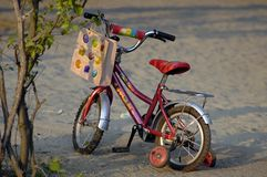 Kiddo bike. Children red bicycle in the park Royalty Free Stock Images