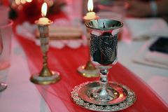 Kiddush Cup with Sabbath Candles Royalty Free Stock Images