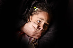 Kidnap. Child being abducted over dark background Royalty Free Stock Photos