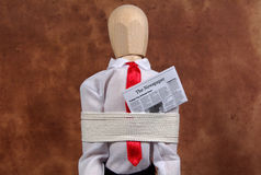 Kidnapped. Mannequin Tied Up With a Newspaper Royalty Free Stock Photography