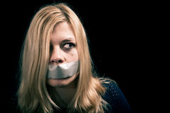 Kidnapped woman hostage with tape over her mouth Royalty Free Stock Photography