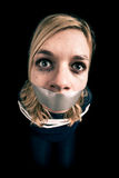 Kidnapped woman hostage. With tape over mouth and tied up with rope Royalty Free Stock Image