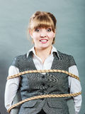 Kidnapped woman tied with rope to chair. Stock Images