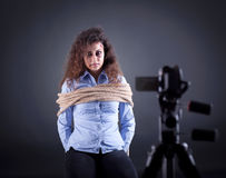 Kidnapped young woman in front of the camera hijackers Stock Photos