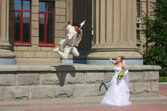 Kidnapping of a bride 3. Bride and groom walking around Novosibirsk, Siberia Stock Images