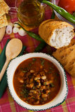Kidney bean soup. Kidney bean vegetable soup served with bread and hot peppers Royalty Free Stock Photos