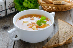 Kidney bean soup in white bowl and rye bread Stock Photo