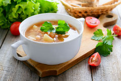 Kidney bean soup on wooden table Royalty Free Stock Photo