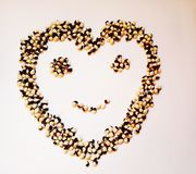 Kidney beans two colores in form of heart and smiling face on the white background. Kidney beans two colores form heart smiling fac face white background royalty free stock photos