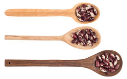 Kidney beans on a wooden spoon isolated on white background. Top view Stock Photo
