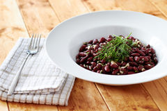 Kidney beens dish on white plate in front view Royalty Free Stock Photography
