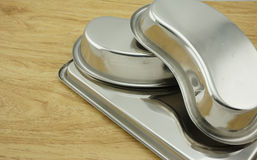 Kidney bowl and tray on table Stock Image