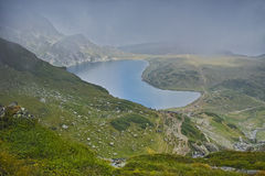 The Kidney lake and approaching clouds, The Seven Rila Lakes Stock Images