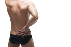 Kidney pain. Man with backache. Pain in the human body. Muscular male body. Isolated on white background Stock Photos