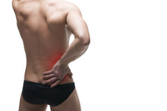 Kidney pain. Man with backache. Pain in the human body. Muscular male body. Isolated on white background. With red dot Stock Photos