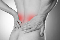 Kidney pain. Man with backache. Pain in the man's body Stock Images