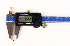 Kidney stone measurement. A real human kidney stone is measured by calipers as 4.23 mm stock image