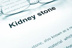 Kidney stone sign on a paper and glasses. Medical concept Royalty Free Stock Photography