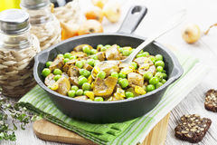 Kidneys with green peas and curry Royalty Free Stock Photography