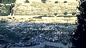 Kidron Valley Jewish cemetery of Jerusalem. With of the monumental rock-cut Tomb of Benei Hezir and Tomb of Zechariah. ancient Jewish cemetery from Olive mount stock video