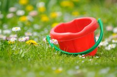 Kids' Sand Bucket in the Garden Stock Images