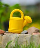 Kids' Watering Can in the Garden Stock Photo