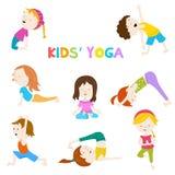 Kids& x27;瑜伽集合 库存照片