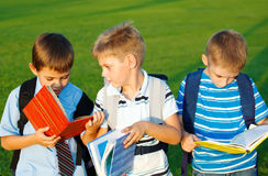 Kids. With books  in park Stock Photography